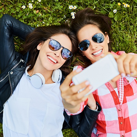 Two women outdoors taking a selfie