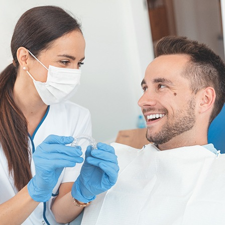 Dentist and patient smiling at Invisalign consultation