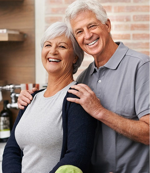Smiling older man and woman after restorative dentistry