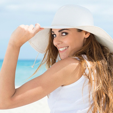 woman on beach with white smile