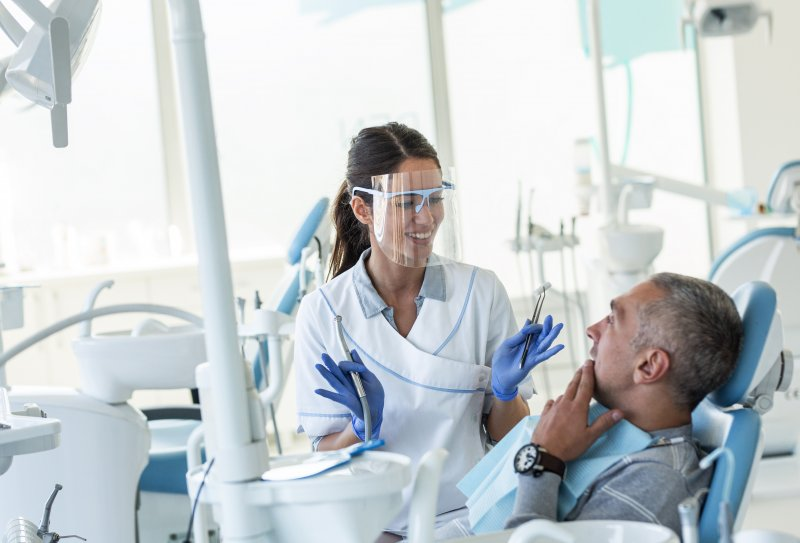 Dentist talking to patient about root canal