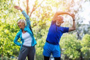 senior couple exercising to prevent gum disease in Annapolis